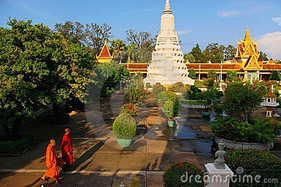Buddhist monks in garden of Royal Palace Editorial Photo