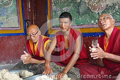 Buddhist monks preparing butter sculptures Editorial Photo