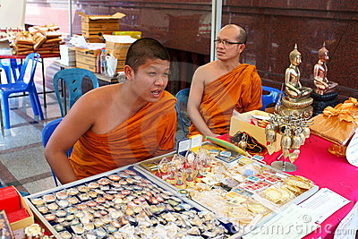 Buddhist Monks selling Amulets Editorial Image
