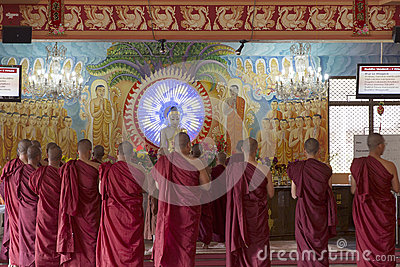 Buddhist Monks Worshipping Buddha in Temple Editorial Stock Image