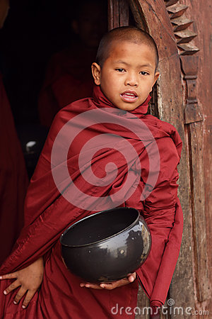 Buddhist novice at a teak monastery Editorial Photography