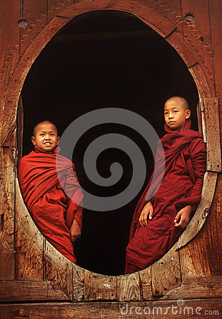 Buddhist novices at a teak monastery Editorial Image