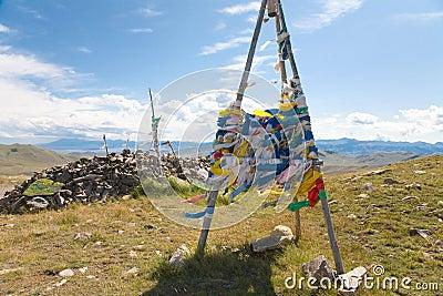 Buddhist prayer flags on mountain pass