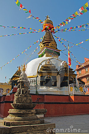 Buddhist stupa with colorful prayer flags
