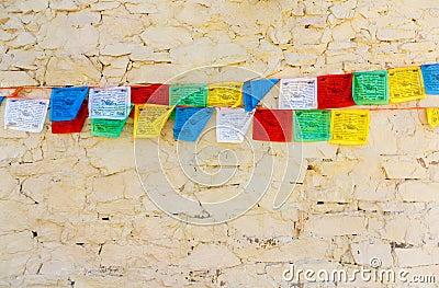 Buddhist tibetan prayer flags against wall