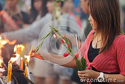 Buddhist woman praying