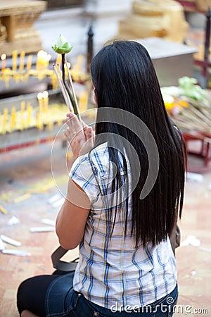 Buddhist woman praying on eve Editorial Stock Photo