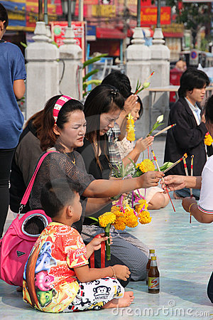 Buddhist worshiping and making religious merit Editorial Image