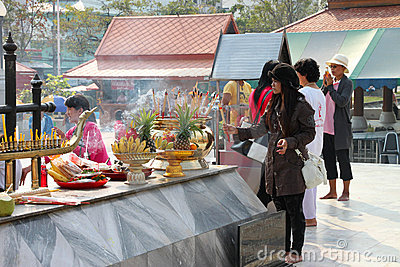 Buddhist worshiping and making religious merit Editorial Stock Photo