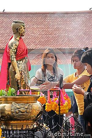 Buddhist worshiping and making religious merit Editorial Stock Photo