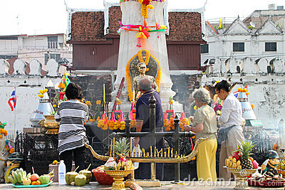 Buddhist worshiping and making religious merit Editorial Photo
