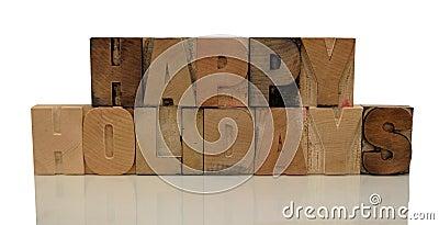 Buenas fiestas en tipo de madera de la prensa de copiar