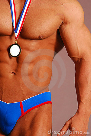 buff male bodybuilder with medal