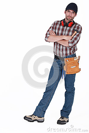 Builder with arms folded