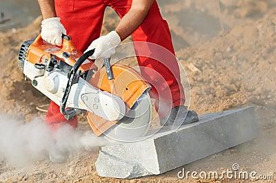Builder at cutting curb work
