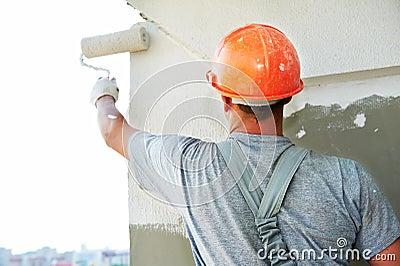 Builder facade plasterer worker