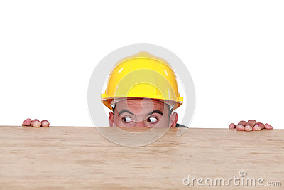 Builder hiding behind a table