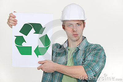 Builder holding recycling symbol