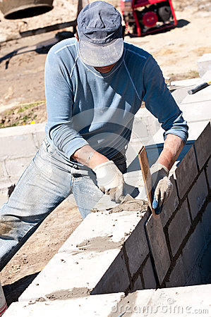 Builder laying bricks