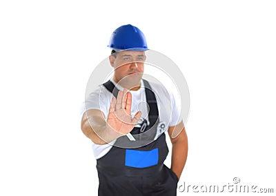 Builder making stop sign