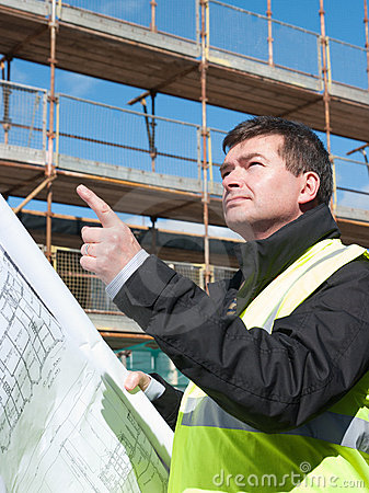 Builder points up at construction site