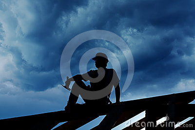 Builder resting on top of roof