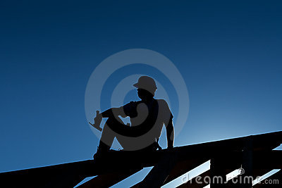 Builder resting on top of roof structure