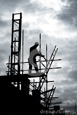 Builder on scaffold building site