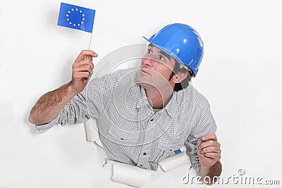 Builder waving a European flag