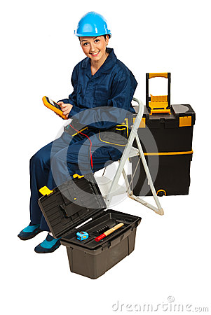 Builder woman with voltage tester