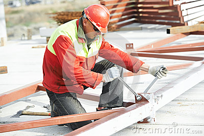 Builder worker assembling metal construction