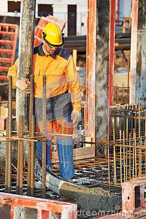 Builder worker at concrete pouring work