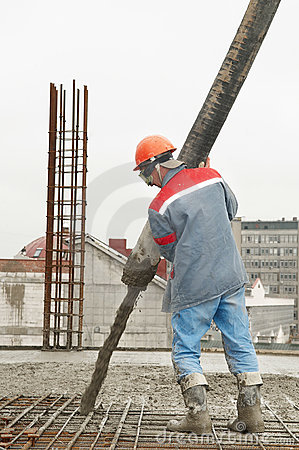 Builder worker pouring concrete