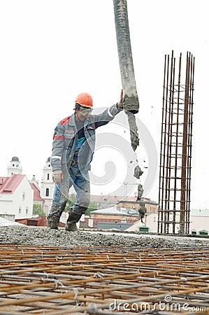 Builder worker pouring concrete