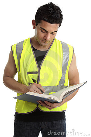Builder writing in a book