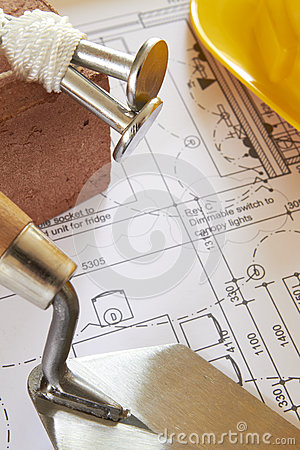 Builders Tools Arranged On House Plans