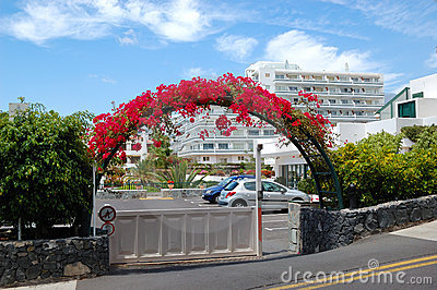 Building and arc with flowers of luxury hotel