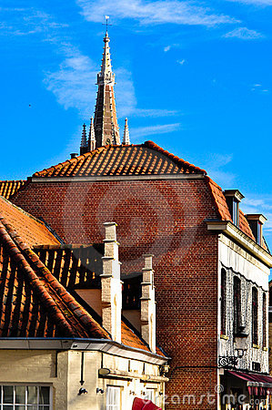 Building in Bruges with church spire