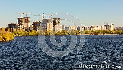 Building of city habitation on bank big river