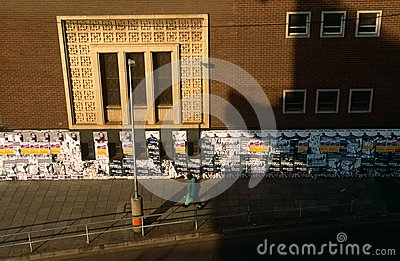 A building covered in posters on the lower part, south Africa Editorial Stock Photo