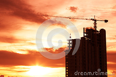 Building crane and building Sunset
