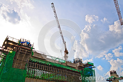 Building crane and building under construction.