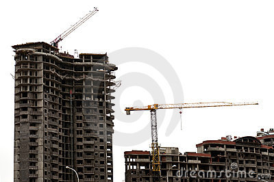 Building exteriors and cranes on white