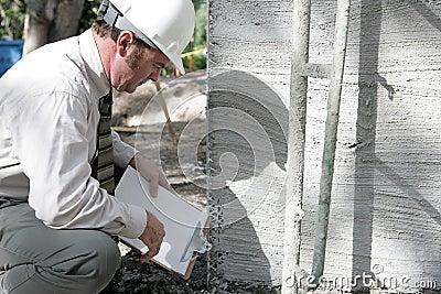 Building Inspector Checks Foun