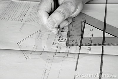 Building plans being drawn B
