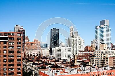 Building rooftops under blue sky