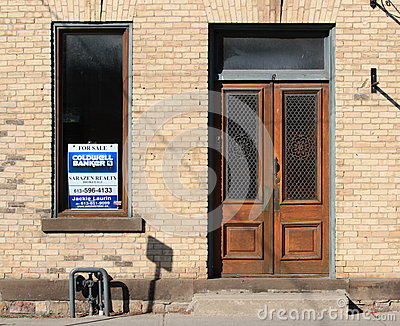 Building for Sale with Wooden Doors Editorial Photography