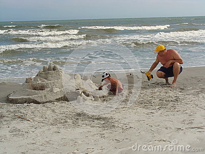 Building a sandcastle on a beach