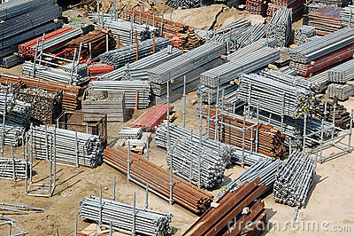 Storage Yard At Construction Site With Scaffolding Components And