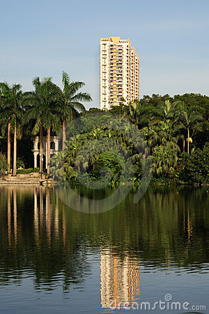 A building standing besides a lake